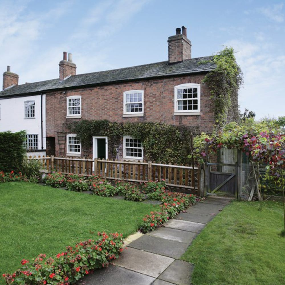 Country cottage featuring sash windows