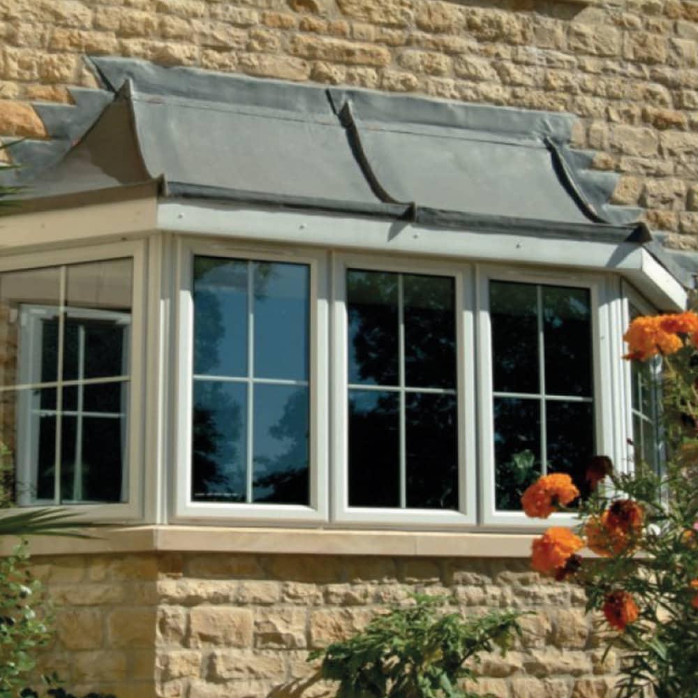 Bay & Bow windows on a stone house